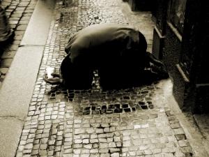 man kneeling on the street